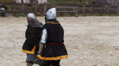 Middle Ages. Sword fighting tournament between two knights in heavy steel armor Arkistovideo