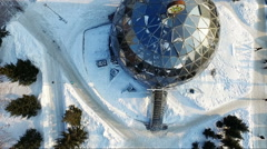 Flying over the small city park in winter. round building. spherical building Stock Footage