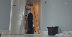 Friends work in new home - stock footage