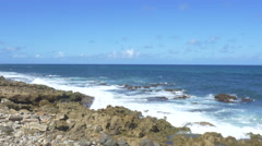 Waves crashing over rocks in Puerto Rico - stock footage