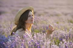 Enjoying the fragrance - stock photo