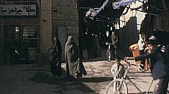 Shiraz, Iran 1973: women walking in the street Stock Footage