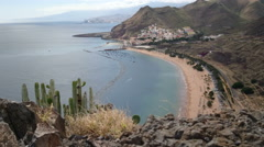 Teresitas beach, in northern Tenerife, with view of hills facing the ocean Stock Footage