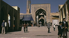 Isfahan, Iran 1973: people walking in front of the Mosque - stock footage