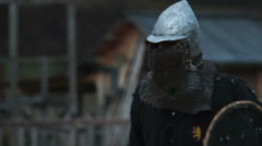 Knight tournament. Two opponents in medieval clothes and steel armor fighting Stock Footage