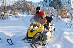 Athlete on a snowmobile. Stock Photos