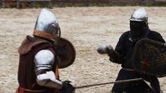 Medieval fighting technique, practice and learning of two young, brave knights Stock Footage