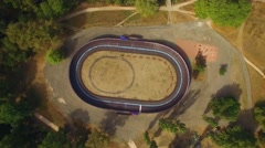 AERIAL VIEW. New Modern Cycle Track In Green Park Stock Footage
