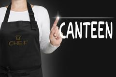 canteen touchscreen is operated by chef - stock photo