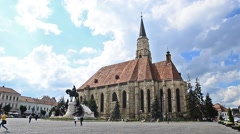 St Michael Cathedral in the Unirii Square in Cluj Napoca Transylvania, Romania Stock Footage