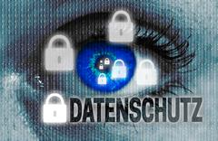 Data protection (in german datenschutz) eye looks at viewer concept Stock Photos