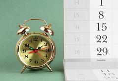 Alarm clock and calendar Kuvituskuvat