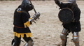 Martial arts competition, strong men reenacting duel between two medieval rivals HD Footage