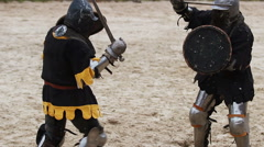 Martial arts competition, strong men reenacting duel between two medieval rivals - stock footage
