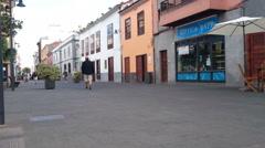 People walking in small street in La Laguna, Tenerife Stock Footage