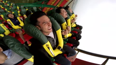 Asian people in rollercoaster Stock Footage