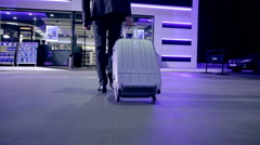 Businessman goes with suitcase to a roadside cafe Stock Footage