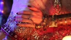 Golden Oriental Jewelry and Accessories: Female Hands with Indian Jewellery. - stock footage