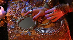 Golden Shiny Oriental Jewelry and Accessories: Female Hands with Mirror and b Stock Footage
