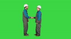 Two builder, architects handshaking on a Green Screen, Chroma Key - stock footage