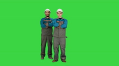 Industry, building, construction and people concept - happy male builders on a Stock Footage