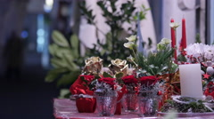 Stock Video Footage of Christmas floral arrangements on a stall at a market in Graz