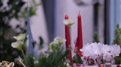 Stock Video Footage of Christmas floral arrangements with candles on a stall at a market in Graz
