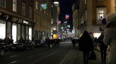 People walking by NC Digitalis computer store on Murgasse on Christmas in Graz Stock Footage