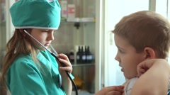 Boy and girl playing doctor and patient - stock footage