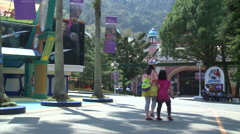 Two girls in Formosan Aboriginal Culture Village, Taiwan Stock Footage
