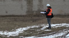 Engineer filmed the building wall Stock Footage