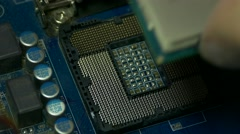 Ungraded: Man's Hand Puts Intel I5 Processor Into Motherboard Socket And Stock Footage