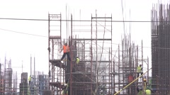 Working on site construction engineers and workers, steel pipes, new building 4K Stock Footage