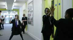 4K Frozen in time - teachers & pupils in still positions in school corridor - stock footage