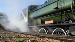 Steam engine by platform billows steam - stock footage