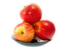 ripe red apples on a plate - stock photo