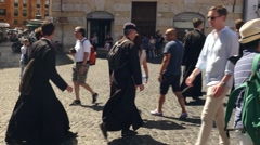 Traditional Catholic priests in Rome Stock Footage