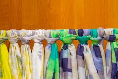 colored scarves tied like a tie - stock photo