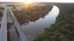 Drone footage of Highway 67 and a bridge spanning the Brazos River in Texas. Stock Footage