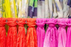 Colored scarves tied like a tie Stock Photos
