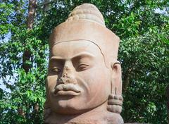 Ancient stone face near Bayon Temple, Angkor Wat complex, Siem Reap, Cambodia Stock Photos