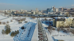 Flight over the bridge element. flying over the frozen river. city quay Stock Footage