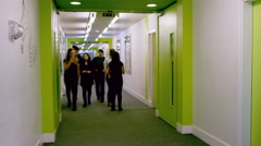 4K Time lapse diverse group of school children walking through school hallway - stock footage