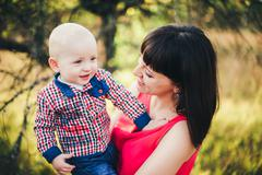 Mother with her baby son in autumn park Stock Photos