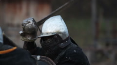 Fierce battle between two knights in steel armor, medieval tournament in action Stock Footage