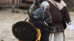 Two knights sword fighting in steel armor. Reenactment of historical tournament Arkistovideo
