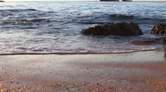 The woman barefoot walks on the beach Stock Footage