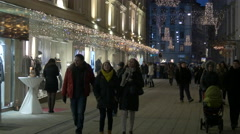 Walking and riding bikes in the Hauptplatz on Christmas in Graz Stock Footage