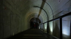 Family walking through the Schlossberg Tunnel on Christmas in Graz Stock Footage