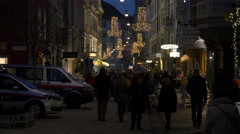 Walking by the Police Inspection on Schmiedgasse street on Christmas in Graz - stock footage